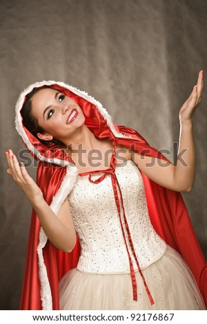 Beautiful girl in christmas dress - stock photo