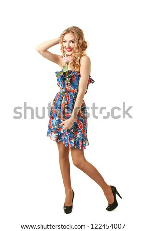 Beautiful girl in colorful retro dress  standing with pink rose isolated on white