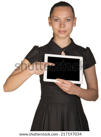 Beautiful girl in dress holding tablet and pointing at screen