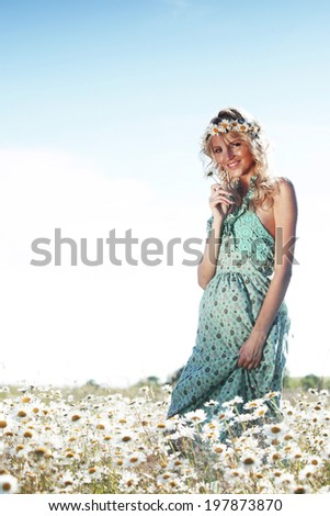 beautiful girl  in dress on the daisy flowers field  - stock photo