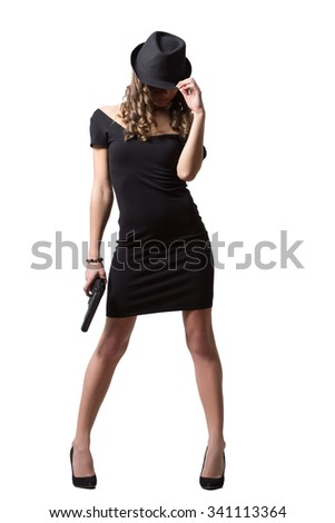 beautiful girl in evening dress and hat holding gun. Isolated on white background - stock photo
