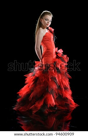 Beautiful girl in evening dress on a black background - stock photo