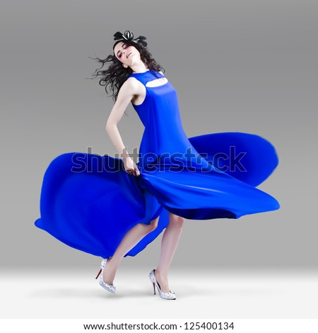 Beautiful Girl In Exquisite Fashion Style Dance - stock photo