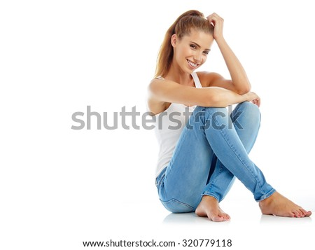 beautiful girl in fashion stylish jeans - isolated on white. Fashion model posing at studio