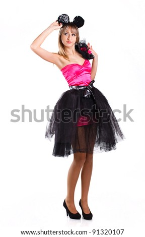 beautiful girl in festive dress with mouse ears on a white background