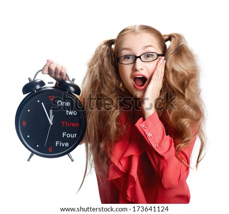 Beautiful girl in glasses with a big clock in panic. - stock photo