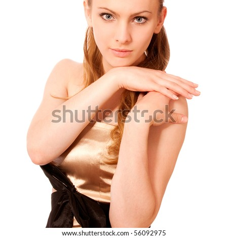 Beautiful girl in golden dress has put palms on shoulder, it is isolated on white background.