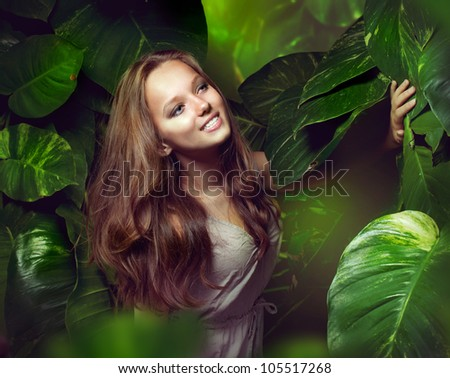 Beautiful Girl in Green Mystical Forest.Tropic - stock photo