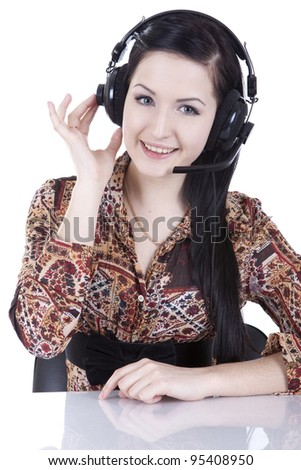 Beautiful girl in headphones with a microphone talking - stock photo