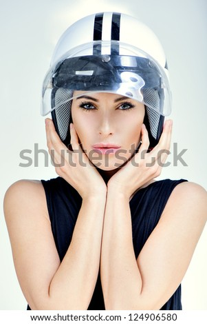 beautiful girl in helmet from scooter poses front chamber - stock photo