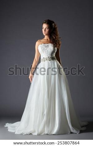 Beautiful girl in luxurious wedding dress - stock photo