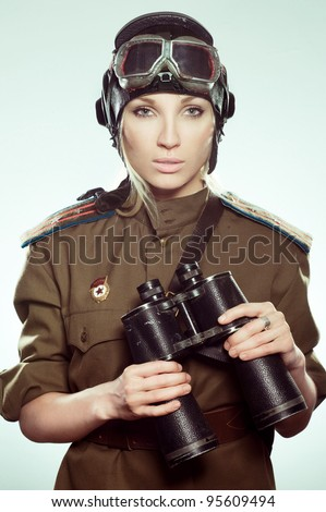 Beautiful girl in military clothes as aviator - stock photo