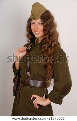 beautiful girl in military uniform on grey background
