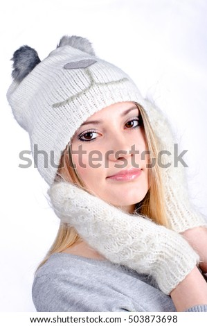 beautiful girl in mittens and hat