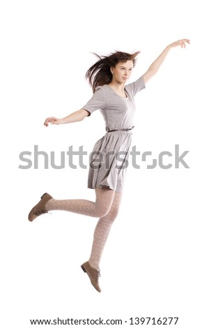 beautiful girl in motion isolated on white backround
