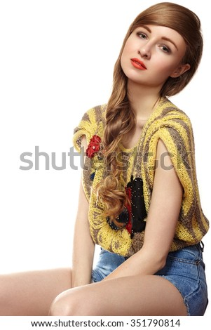 Beautiful girl in nice retro knitted sweater and denim jeans. Fashion tender style, bright lips make-up. Studio portrait of cute woman with long curly hair. Happy smiling model. Happiness smile  - stock photo