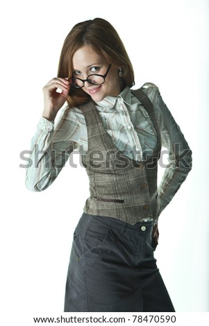 beautiful girl in office clothes in glasses