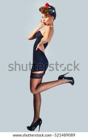 Beautiful girl pinup style stock photo 521489089 for Tatuaggi stile pin up