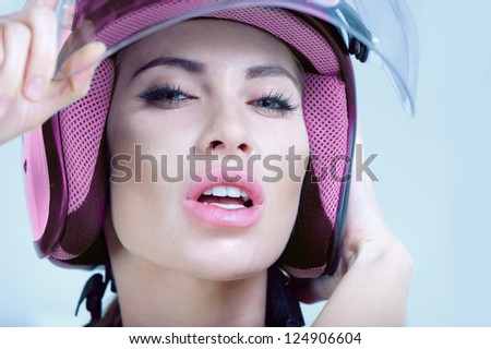 beautiful girl in pink helmet from scooter poses front chamber - stock photo