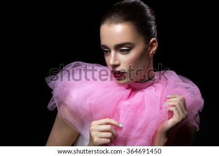 Beautiful girl in pink lace collar - stock photo
