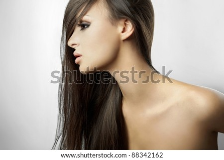 Beautiful girl in profile, with long hair isolated on white background - stock photo