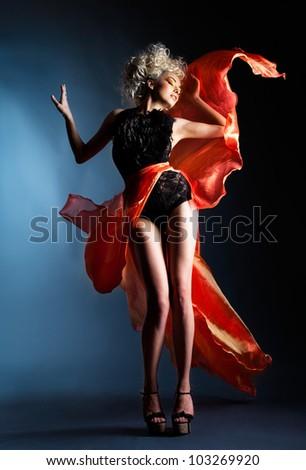 Beautiful girl in red dress - stock photo