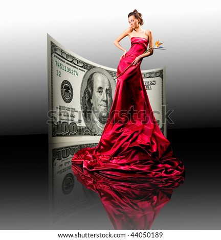 Beautiful girl in red dress. money, 100 american dollars - stock photo