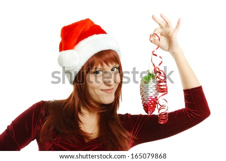 Beautiful girl in Santa hat with a decoration for the Christmas tree on a white background - stock photo