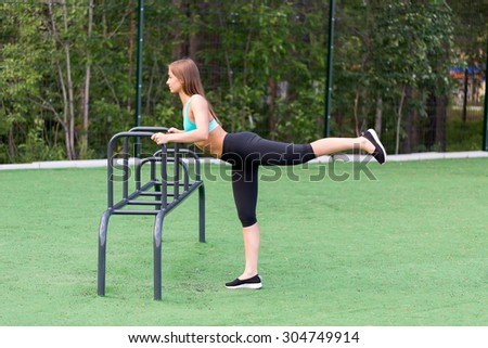 beautiful girl in sportswear on the playground doing fitness. - stock photo