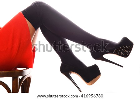 Beautiful girl in stockings and black suede high-heeled shoes - stock photo
