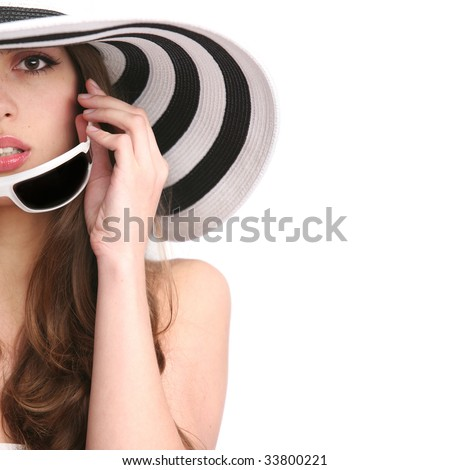 beautiful girl in striped hat and sunglasses on the white background - stock photo