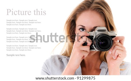 Beautiful Girl in Studio with Camera with Text Space to the Left - stock photo