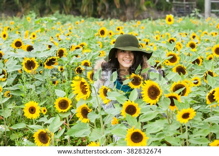 beautiful girl in sunflower garden - stock photo