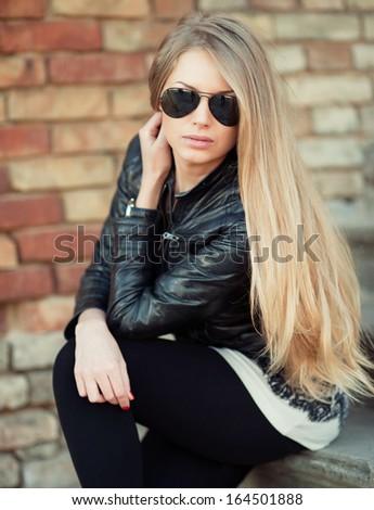 Beautiful girl in sunglasses - stock photo