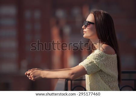 Beautiful girl in sunglasses enjoying the freshness. Sunset summer. - stock photo