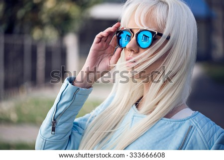 Beautiful girl in sunglasses outdoors - stock photo
