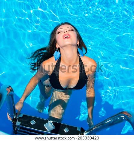 Beautiful girl in swimming pool - stock photo