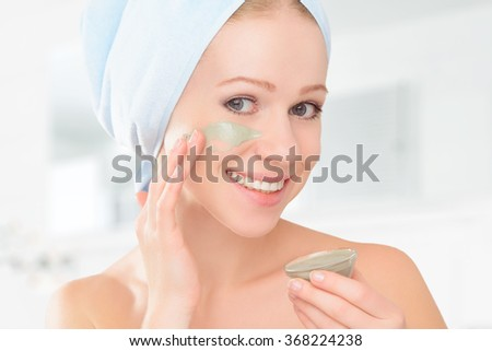 beautiful girl in the bathroom and mask for facial skin care - stock photo