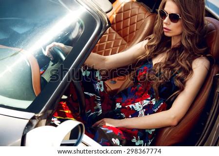 Beautiful girl in the car - stock photo
