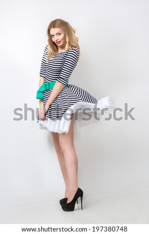 beautiful girl in the developing dress. pin up - stock photo