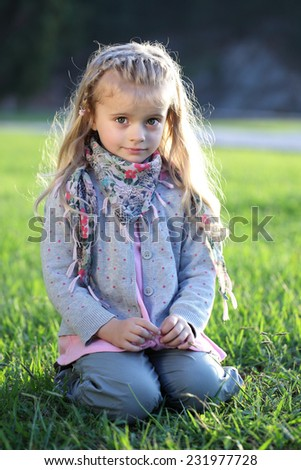 Beautiful girl in the garden in the countryside. Happy children. Healthy people.