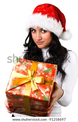 beautiful girl in the hat of Santa Claus with a gift on a white background