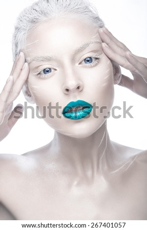 Beautiful girl in the image of albino with blue lips and white eyes. Art beauty face. Picture taken in the studio on a white background.