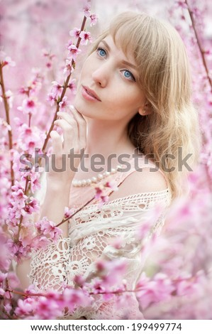 beautiful girl in the peach garden - stock photo
