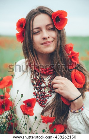 beautiful girl in the poppy field. Ukrainian national clothes