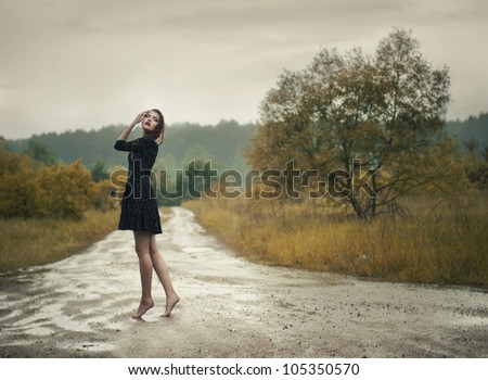 beautiful girl in the rain - stock photo