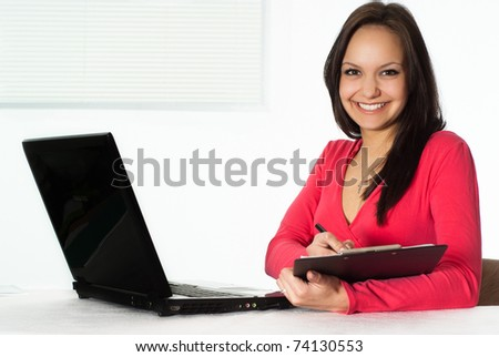 beautiful girl in the red with a laptop
