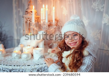Beautiful girl in the room. Christmas decorations, candles - stock photo
