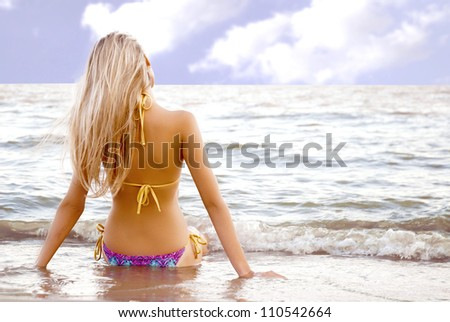 beautiful girl in the sea on a sunny day