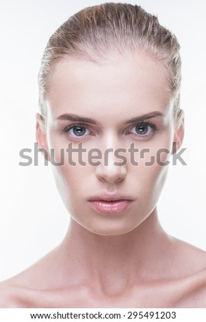 Beautiful girl in the studio on a white background looks ahead